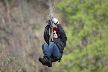 A man having fun on one of the zip line tours near Denver