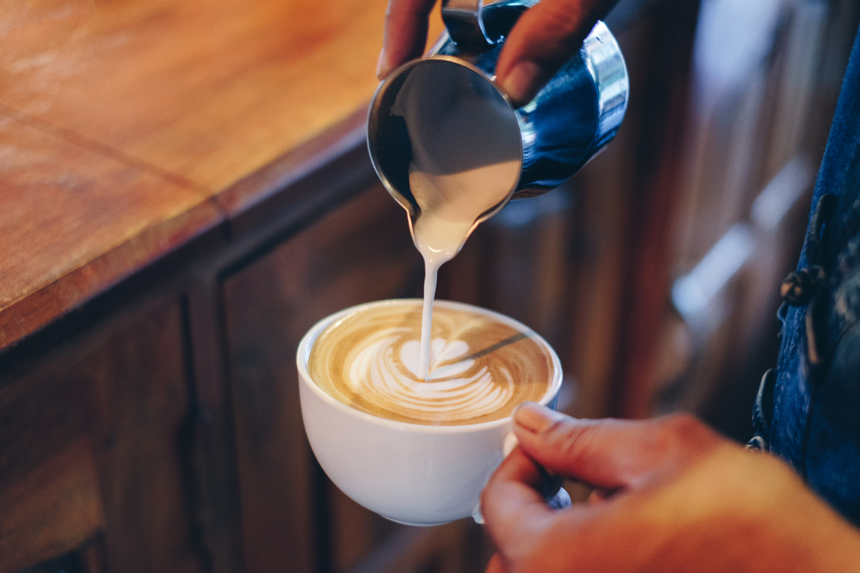person making a latte